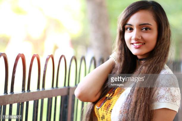 young indian girl portrait - one teenage girl only stock pictures, royalty-free photos & images