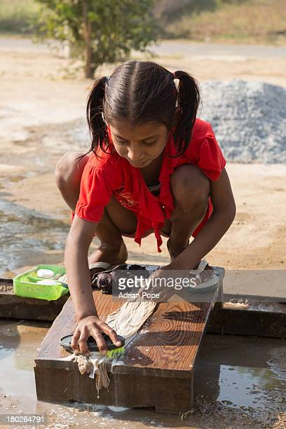 Young Indian girl washing clothes by hand