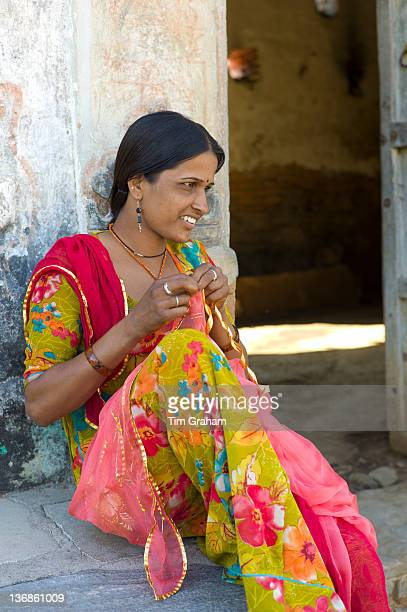 Young Indian Hindu girl age 20 sewing bridal veil at home in Tarpal in Pali District of Rajasthan Western India