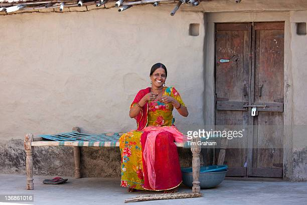 Young Indian Hindu girl sewing bridal veil at home in Tarpal in Pali District of Rajasthan Western India