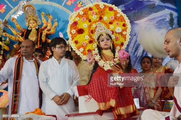 A young Indian Hindu unmarried girl known as a 'kumari' is dressed as the Hindu goddess Durga during a ritual for the Durga Puja festival in Siliguri...