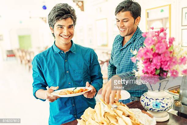 Young Indian Indian students in restaurant buffet