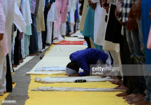 A young Indian muslim boy as others offer prayers on the last congregational friday of the holy month of Ramadan following the Muslim Festival Eid...