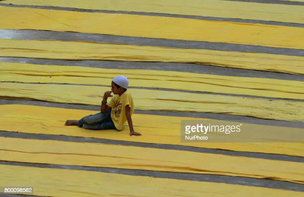 A young Indian muslim boy prepares to offer prayers on the last congregational friday of the holy month of Ramadan following the Muslim Festival Eid...
