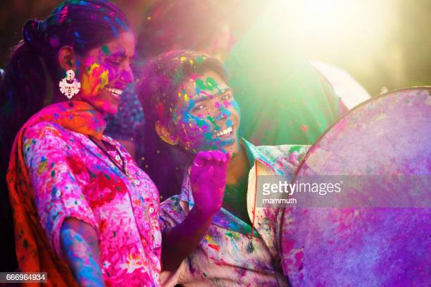 young indian people at holi celebration