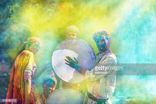 young indian people celebrating holi festival - holi stock pictures, royalty-free photos & images