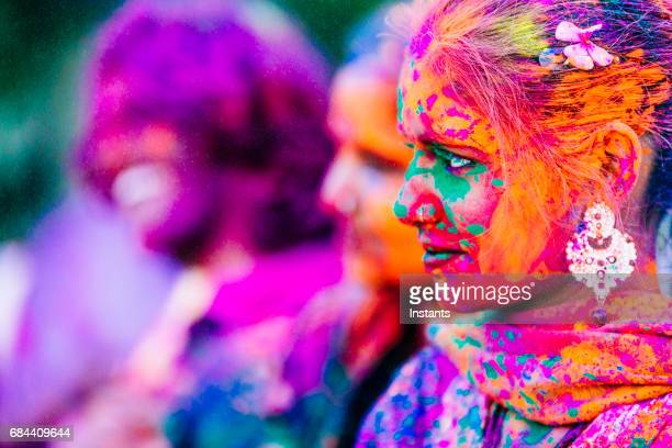 Young Indian people, with their colorful faces and clothes, celebrating the Holi Festival celebration in Jaipur India.
