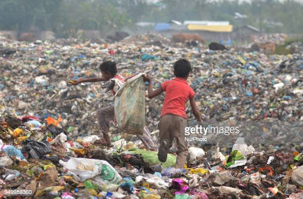 Young Indian rag picker search among piles of garbage at a dumping site on World Earth Day in Dimapur India north eastern state of Nagaland on Sunday...