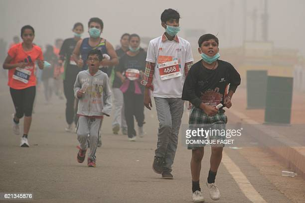 Young Indian runners take part in the New Delhi 10K Challenge amid heavy smog in New Delhi on November 6 2016 Thick smog has blanketed the capital...