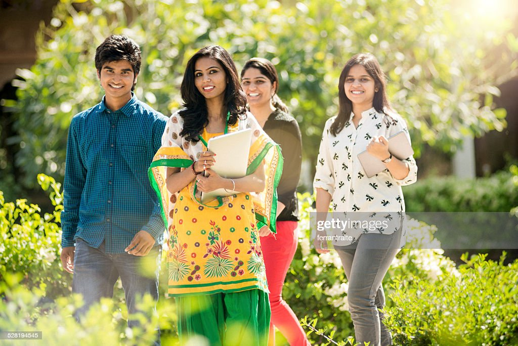 Young Indian Students hanging out on School Grounds : Stock Photo