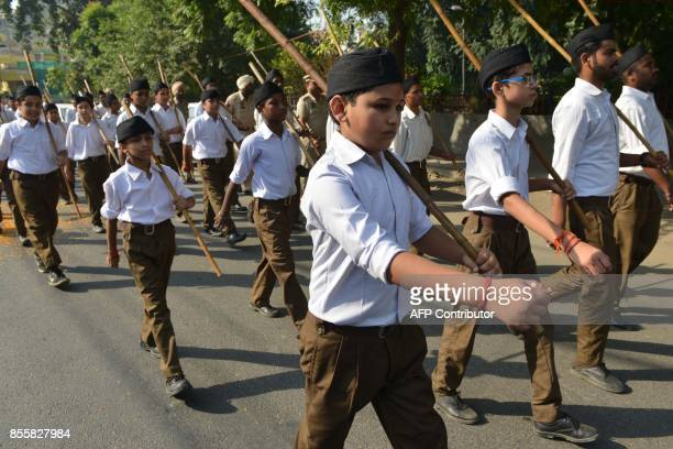 Young Indian volunteers of the Hindu nationalist Rashtriya Swayamsevak Sangh march to mark the organization's foundation day in Amritsar on September...