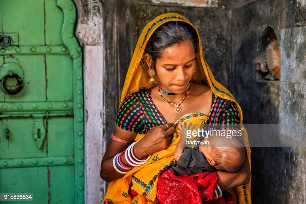 young indian woman breastfeeding her newborn baby, amber, india - indian baby stock photos and pictures