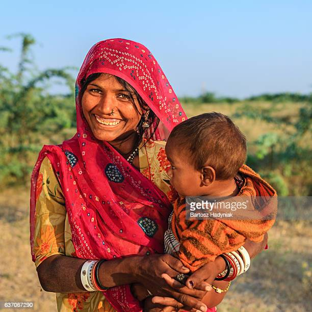 Young Indian woman holding her child