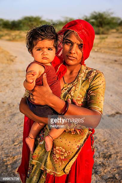 Young Indian woman holding her little baby, Amber, India