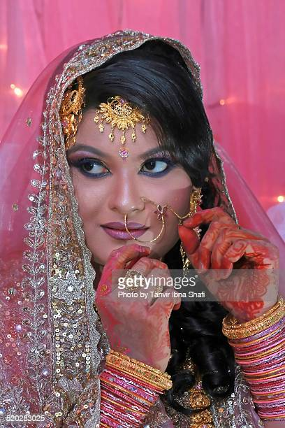 a young indian woman in her wedding day - bangladeshi wedding stock photos and pictures