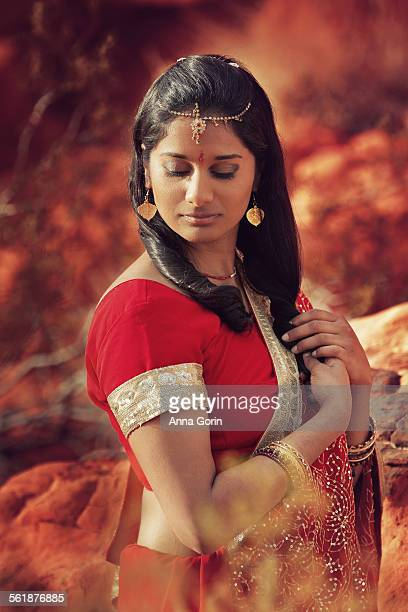 Young Indian woman in sari, desert portrait