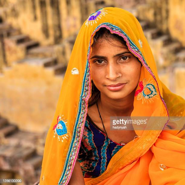young indian woman in village near jaipur, india - religion stock pictures, royalty-free photos & images