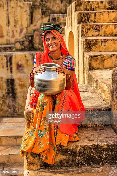 young indian woman in village near jaipur, india - sari stock pictures, royalty-free photos & images