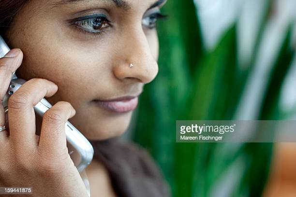 Young Indian woman on phone, close-up