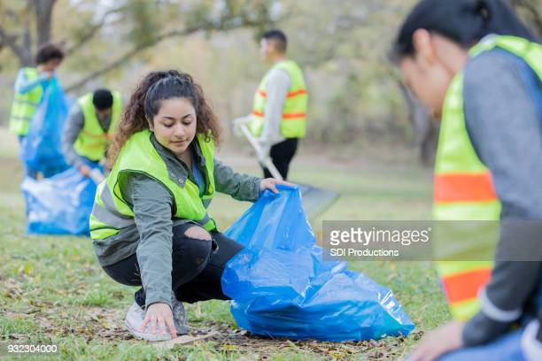 Young Indian woman participating in community beautification