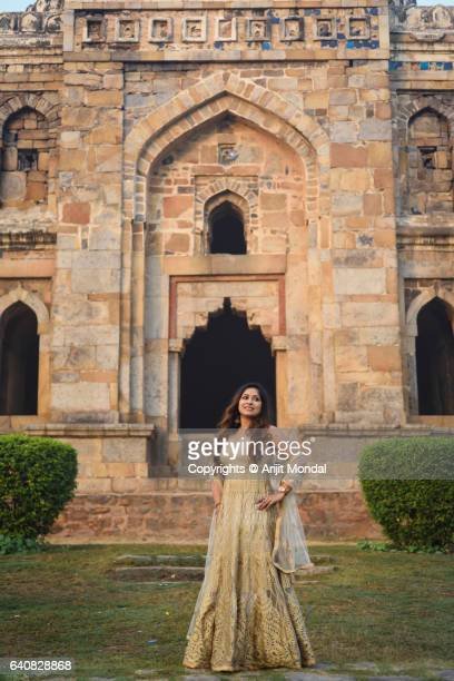 Young Indian Woman Standing Front of a Historical Monument Shisha Gumbad at Lodhi Gardens with Traditional Ethnic Clothing
