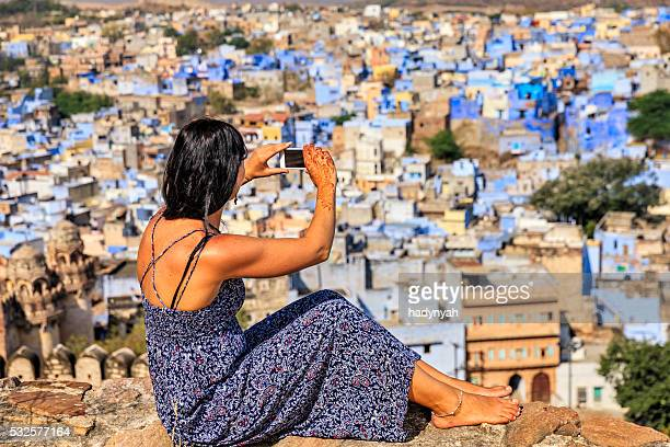 Young Indian woman taking picture using mobile phone, Jodhpur, India