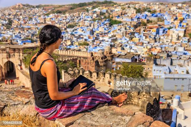 young indian woman using digital tablet, jodhpur, india - barefoot stock pictures, royalty-free photos & images