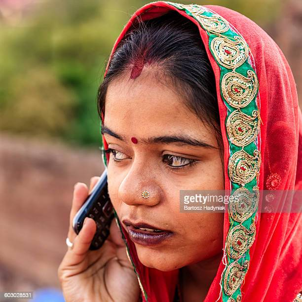 young indian woman using mobile - sari stock pictures, royalty-free photos & images