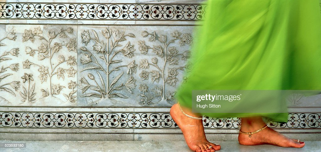 Young Indian woman walking barefooted : Stock Photo
