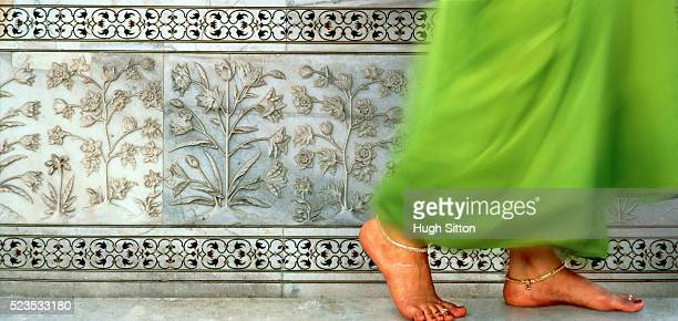 Young Indian woman walking barefooted