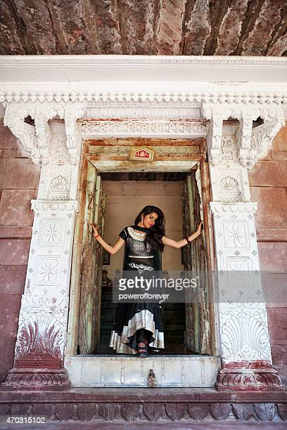 Young Indian Woman Wearing Traditional Clothing Standing in Doorway