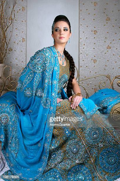young indian woman wearing traditional ornate dress - indian bride stock photos and pictures