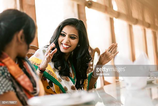 young indian women dining together - indian stock pictures, royalty-free photos & images