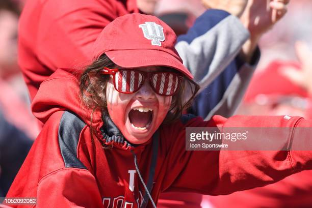 A young Indiana fan screams during a college football game between the Iowa Hawkeyes and Indiana Hoosiers on October 13 2018 at Memorial Stadium in...