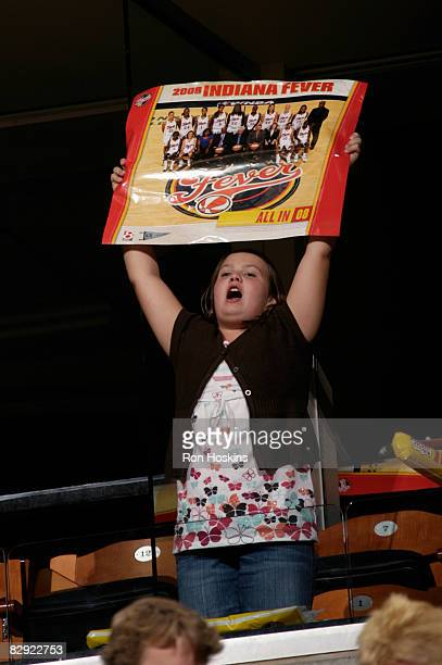 A young Indiana Fever fan cheers for team as they took on the Detroit Shock in Game One of the Eastern Conference Semifinals during the 2008 WNBA...
