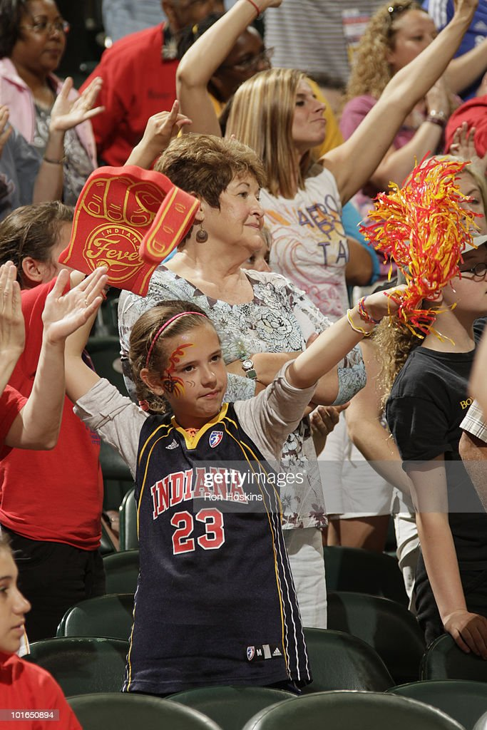 A young Indiana Fever fan enjoys the Fever game with the New York Liberty at Conseco Fieldhouse on June 5, 2010 in Indianapolis, Indiana.