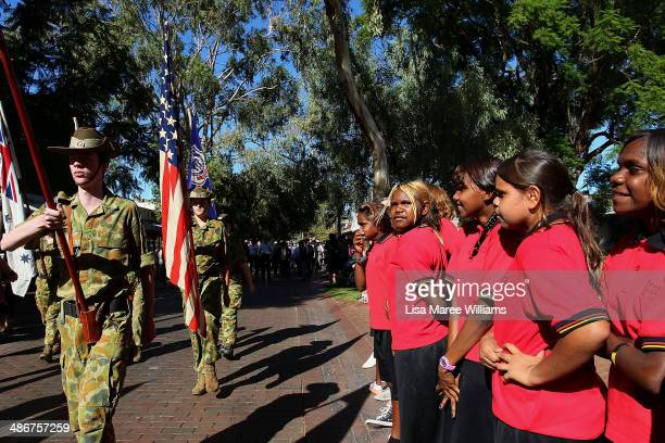 Young Indigenous students from Yirara College attend the ANZAC Day March on April 25 2014 in Alice Springs Australia The Ghan commemorates the...