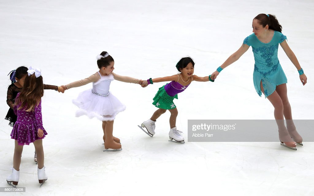 Young individuals enjoy the season's first skate at The Rink at Rockefeller Center on October 11, 2017 in New York City.