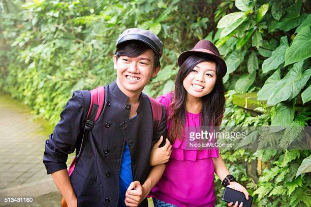 Young Indonesian couple visiting ruins in Bali
