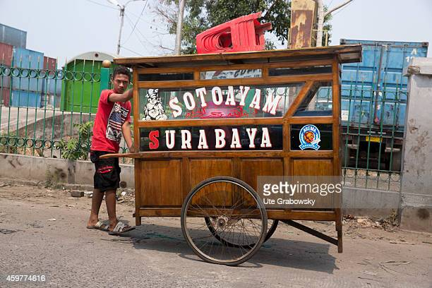 Young Indonesian street vendor with a mobile sales stand on November 02 in Jakarta Indonesia Photo by Ute Grabowsky/Photothek via Getty Images
