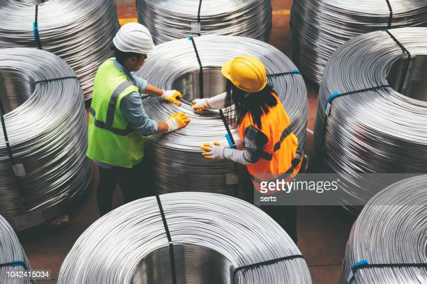 young industry employees checking production line in wire warehouse - cable stock pictures, royalty-free photos & images