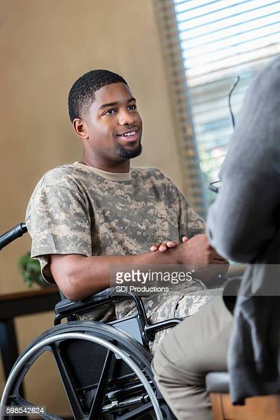 young injured african american soldier talking to miiltary counselor - injured soldier stock photos and pictures