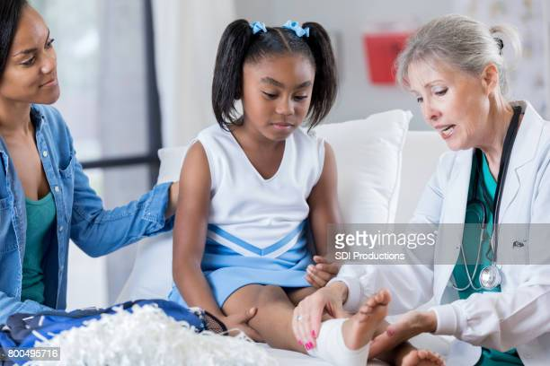 young injured cheerleader in the emergency room - black cheerleaders stock photos and pictures