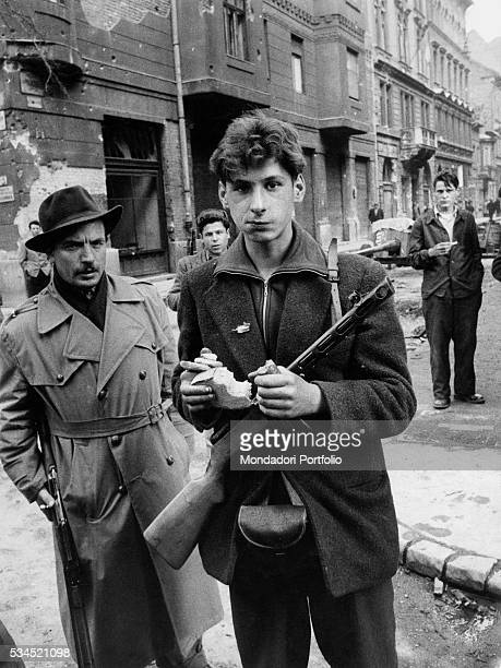 A young insurgent with a rifle during the revolt of the Hungarian people against the Soviet tyranny Budapest November 1956