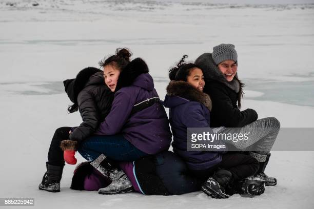 BAY INUKJUAK NUNAVIK QUEBEC CANADA Young Inuit girls playing around and waiting for the arrival of the dogs sleds Since 2001 Ivakkak has been an...