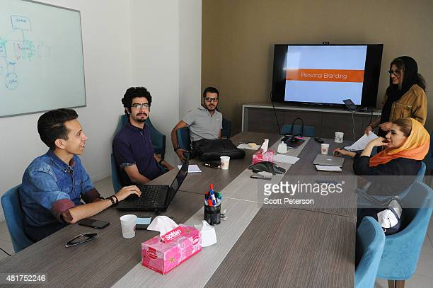Young Iranian hightech and startup specialists prepare for a presentation on personal branding at Sarava a local venture capital firm that invests in...