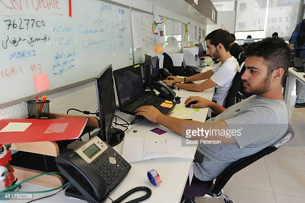Young Iranian hightech and startup specialists work their computers at Sarava a local venture capital firm that invests in startups at Pardis...