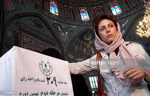 TEHRAN IRAN A young Iranian woman casts her ballot in the presidential runoff between Akbar Hashemi Rafsanjani and Mahmood Ahmadinejad at a mosque in...