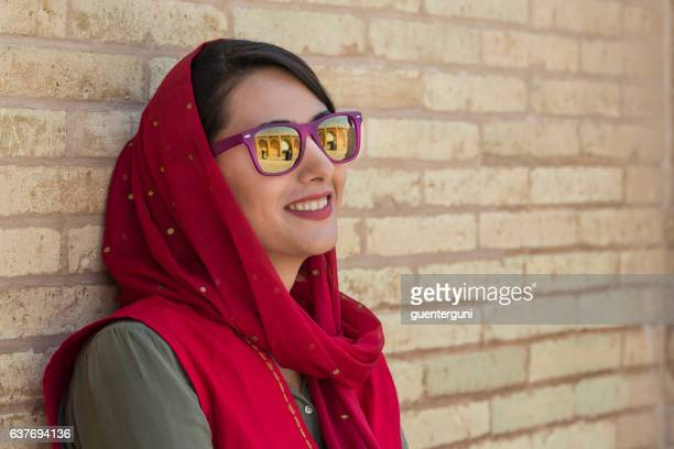 young iranian woman with sunglasses and headscarf, isfahan, iran - iranian woman stock photos and pictures
