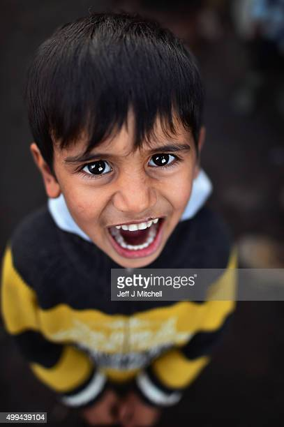 A young Iraqi boy poses for a photograph in the camp known as the 'New Jungle' on December 1 2015 in Calais France Thousands of migrants continue to...